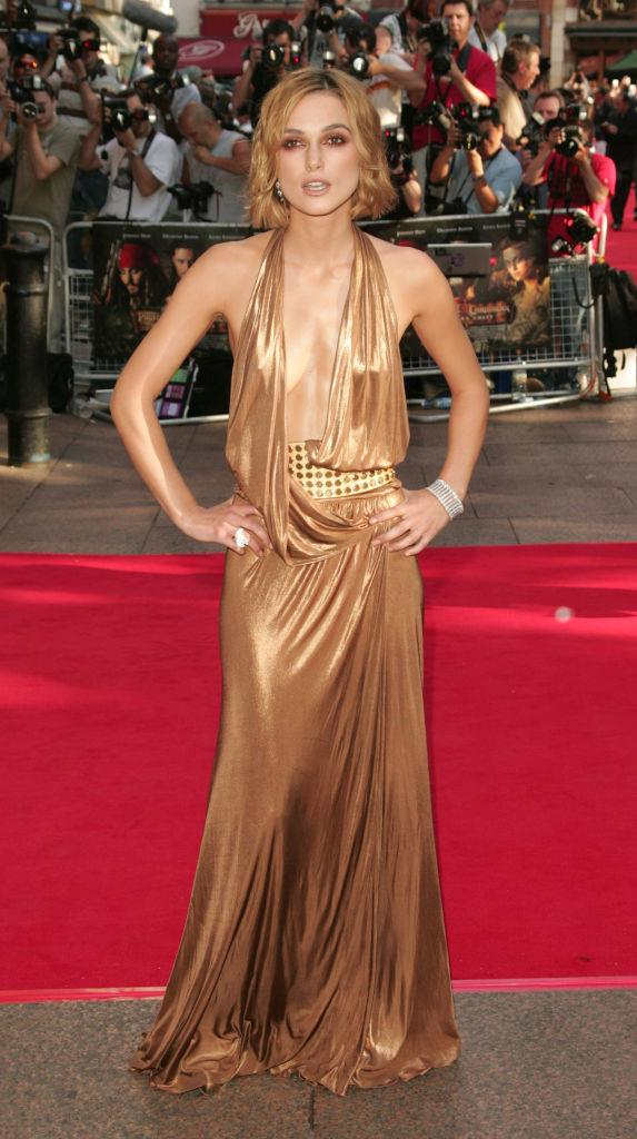 **Keira Knightley in Gucci at the 2006 premiere of** ***Pirates of The Carribean: Dead Man's Chest***<br><br>  Dripping in liquid bronze, Keira Knightley's slick Gucci gown may have been slightly controversial at the time, but its 2000s-meets-2020s appeal makes it a winner in our books.