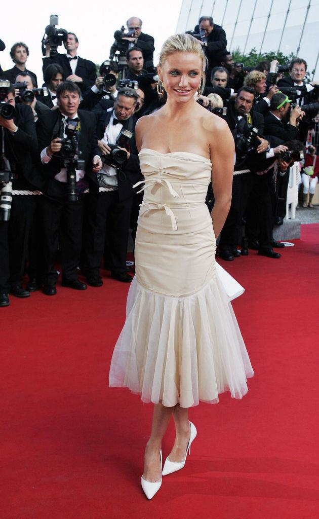 **Cameron Diaz in Louis Vuitton at the 2004 Cannes Film Festival**<br><br>  A departure from the usual sea of billowing gowns, Cameron Diaz famously brought her laid-back L.A.-style to the Cannes red carpet by wearing a Louis Vuitton midi dress with an undone ponytail. Obsessed.