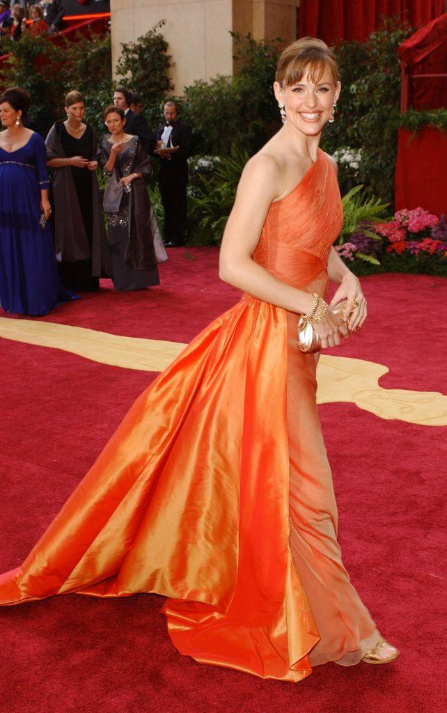 **Jennifer Garner in vintage Valentino at the 2004 Golden Globes**<br><br>  Between her sunny smile and the tangerine-hued vintage Valentino, we're not sure which is more radiant, but we do know this look is an absolute winner.