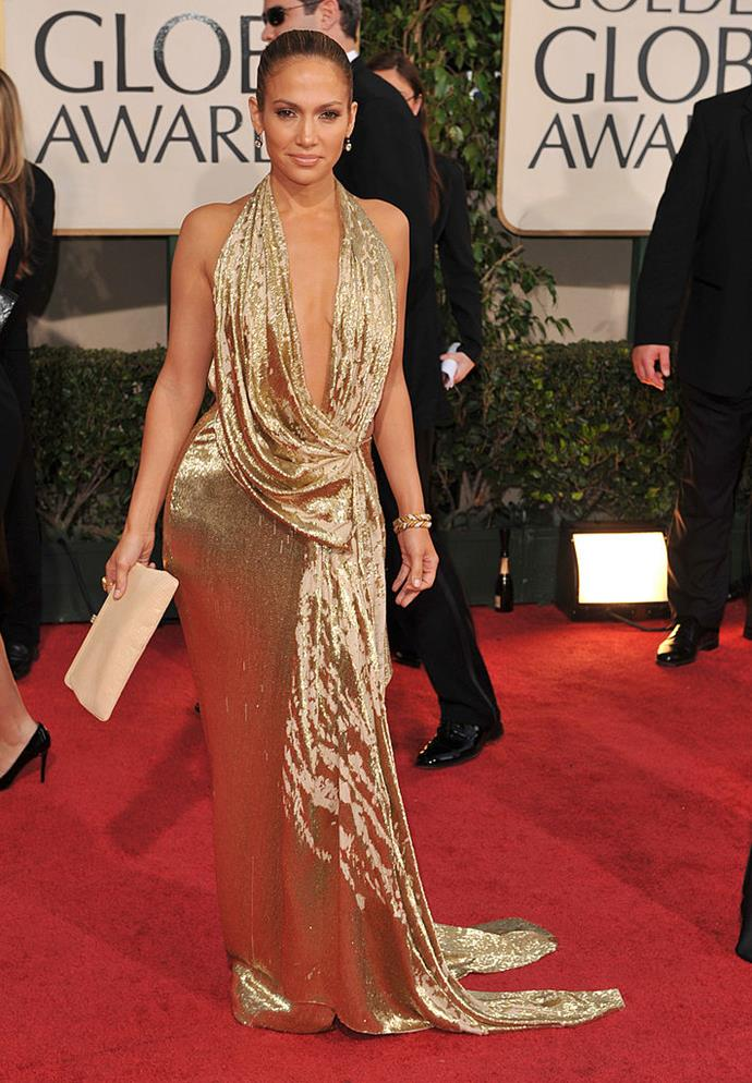 **Jennifer Lopez in Marchesa at the 2009 Golden Globes**<br><br>  JLo practically defined 'glow' (remember the perfume?), and this plunging gold number only added to her radiance.