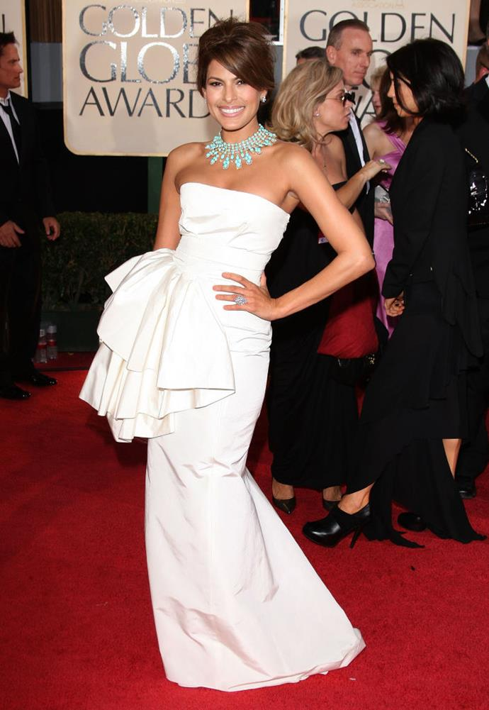 **Eva Mendes in Dior at the 2009 Golden Globes**<br><br>  Everything came together here: the off-white Dior and its elegantly exaggerated hip, Mendes' glowing skin, the turquoise jewellery and the bouffant-esque updo. Divine.