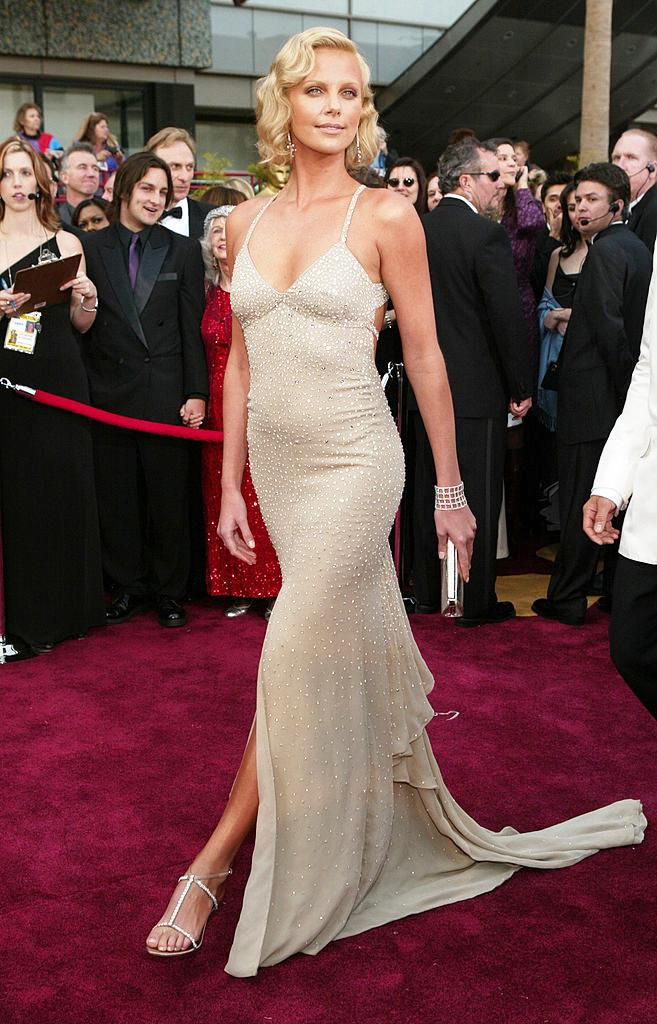 **Charlize Theron in Gucci at the 2004 Academy Awards**<br><br>  While the tan was a little heavy handed (it was the 2000s, we were all guilty), Charlize Theron wearing a glimmering Gucci gown to accept her Academy Award in 2004 was a sight to behold.