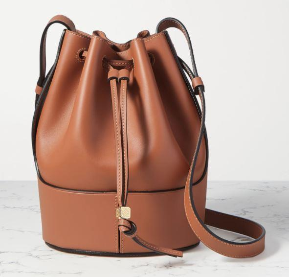 "Small Balloon Bag in Tan by Loewe, $2500 at [Net-A-Porter](https://www.net-a-porter.com/en-us/shop/product/loewe/balloon-small-leather-bucket-bag/1241765|target=""_blank""