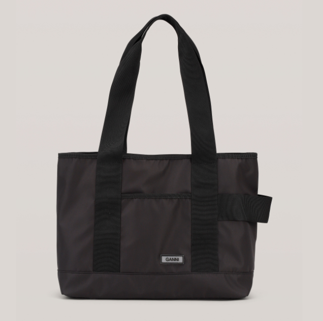 "Recycled Tech Fabric Bag, $285 by [GANNI](https://www.ganni.com/en-au/recycled-tech-fabric-bags-drawstring-bag-A2721.html?dwvar_A2721_color=Black|target=""_blank""
