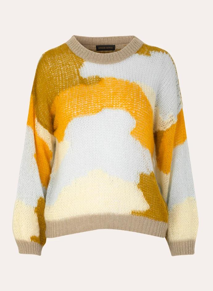 "'Sana' Sweater, $284.46 at [Stine Goya](https://stinegoya.com/collections/knitwear/products/sana-sweater-knit-camouflage-khaki|target=""_blank""|rel=""nofollow"")."