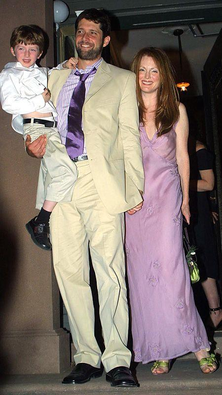 **Julianne Moore**<br><br> The *other* Moore coordinated with husband Bart Freundlich in a lilac slip dress at their wedding in 2003. A low-key affair, the bride even paired her purple dress with moss green accessories, which have weirdly become a chic colour combo again.
