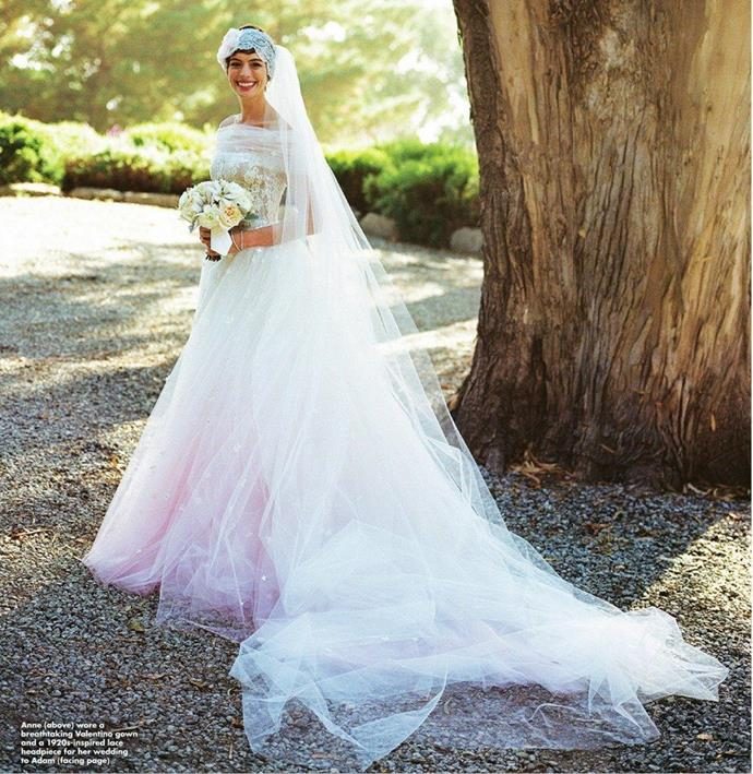"**Anne Hathaway**<br><br> Hathaway wore a custom Valentino gown with an ombré pink tulle skirt to her California nuptials in 2012.  She recalled the dress selection process as a memory she'll never forget. <br><br> ""The memory of creating it with [Valentino] is something that I will treasure forever. He somehow read my mind and designed the dress that I'd always wanted,"" she said."