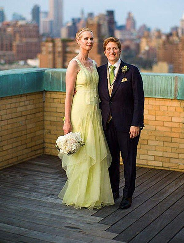 **Cynthia Nixon**<br><br> The former actress (and now politician) wore a gorgeous yellow ruffled dress at her 2012 wedding to long-time partner Christine Marinoni, who wore a classic suit with a sap green tie.