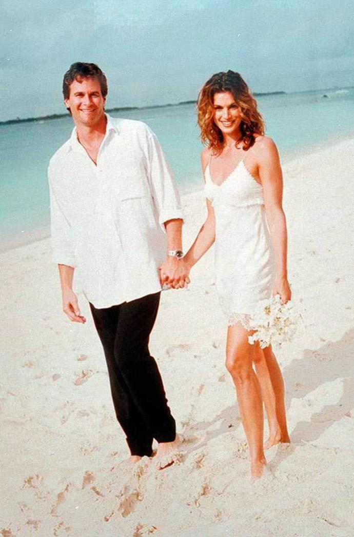 Cindy Crawford wearing a mini sip wedding dress by John Galliano in 1998.