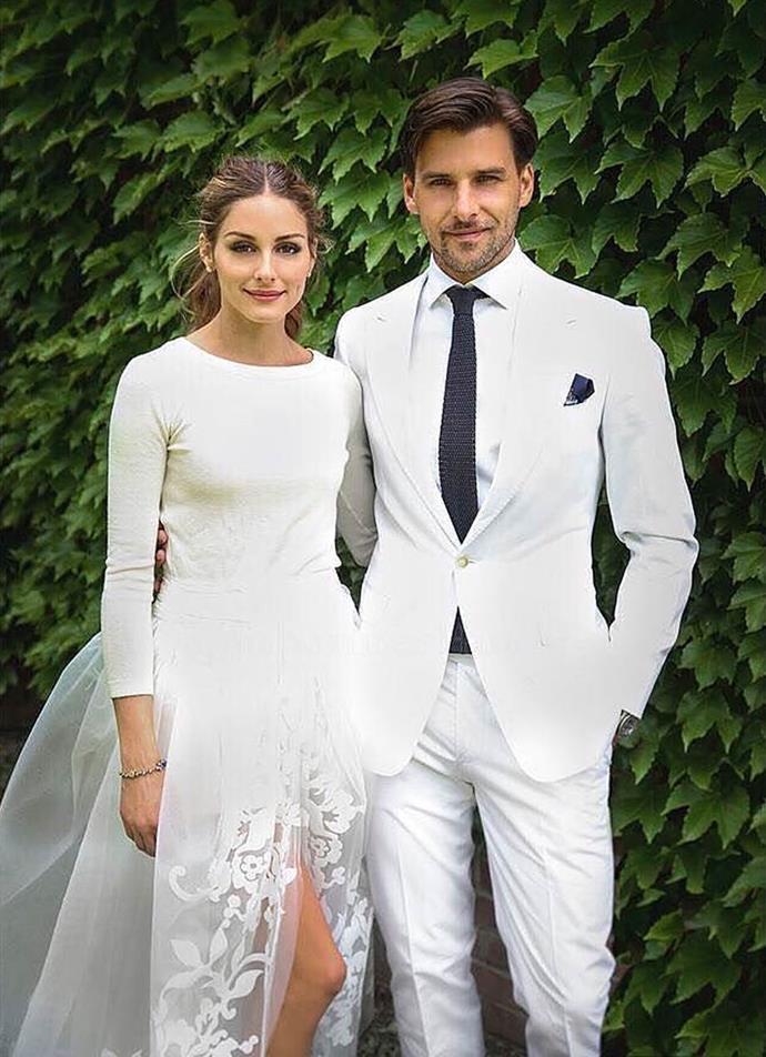 "Olivia Palermo wearing a high-low wedding dress by Carolina Herrera in 2017.<br><br>  *Image via [@thedarlingweddingco](https://www.instagram.com/thedarlingweddingco/|target=""_blank""|rel=""nofollow"")*"