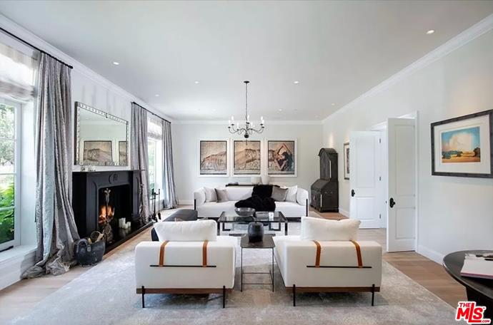 """The formal living room made cosy with plush sofas and a beautiful fireplace. <br><br> *Image by [MLS/Zillow](https://www.zillow.com/homedetails/8-Beverly-Park-Beverly-Hills-CA-90210/20533668_zpid/?