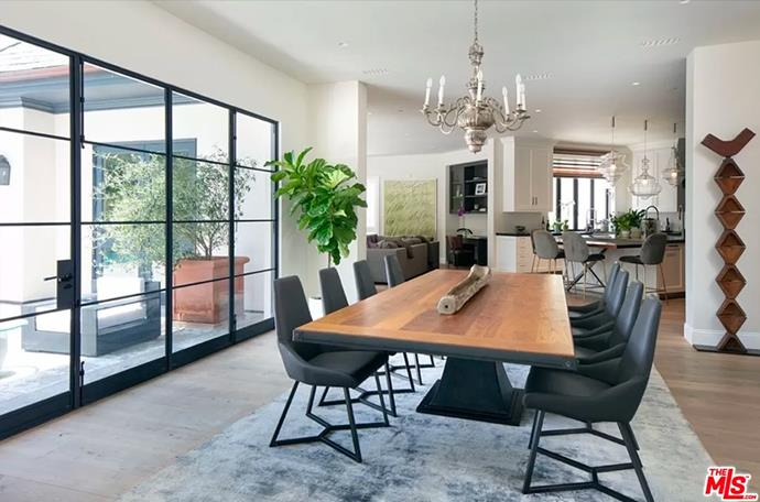 """The formal dining room surrounded by grid-style french doors that open up to the patio. <br><br> *Image by [MLS/Zillow](https://www.zillow.com/homedetails/8-Beverly-Park-Beverly-Hills-CA-90210/20533668_zpid/?