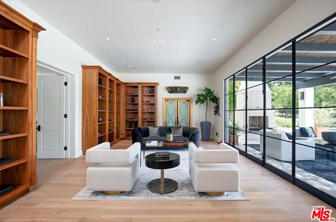 """A joining living space which also looks out to their stunning outdoor area. <br><br> *Image by [MLS/Zillow](https://www.zillow.com/homedetails/8-Beverly-Park-Beverly-Hills-CA-90210/20533668_zpid/?