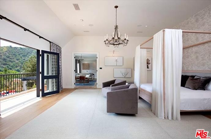 """The master bedroom with high ceilings and a breathtaking view of the hills. <br><br> *Image by [MLS/Zillow](https://www.zillow.com/homedetails/8-Beverly-Park-Beverly-Hills-CA-90210/20533668_zpid/?