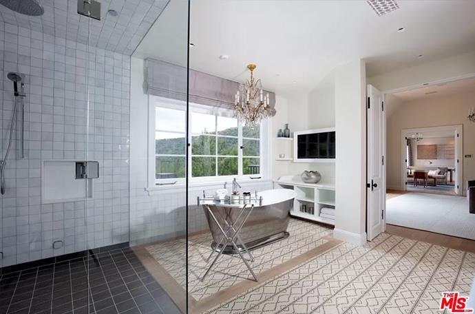 """The master bathroom with metal rolled rim bathtub and walk-in shower. <br><br> *Image by [MLS/Zillow](https://www.zillow.com/homedetails/8-Beverly-Park-Beverly-Hills-CA-90210/20533668_zpid/?