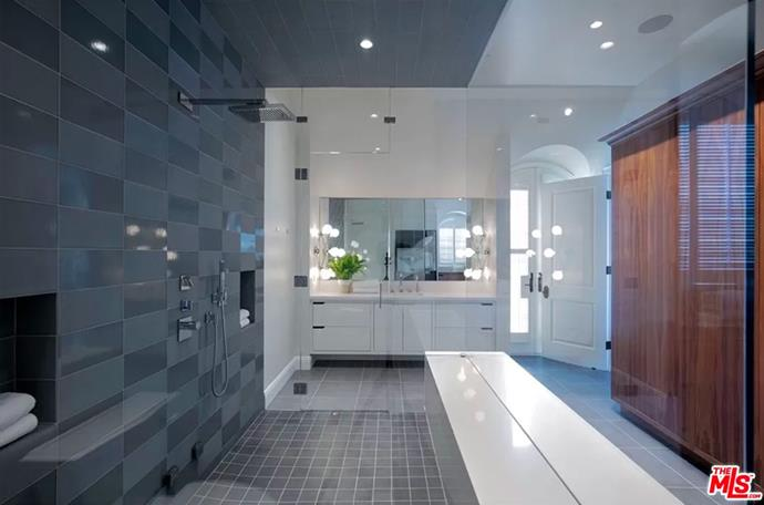 """The guest bathroom fitted with huge walk-in shower and lighted vanity. <br><br> *Image by [MLS/Zillow](https://www.zillow.com/homedetails/8-Beverly-Park-Beverly-Hills-CA-90210/20533668_zpid/?