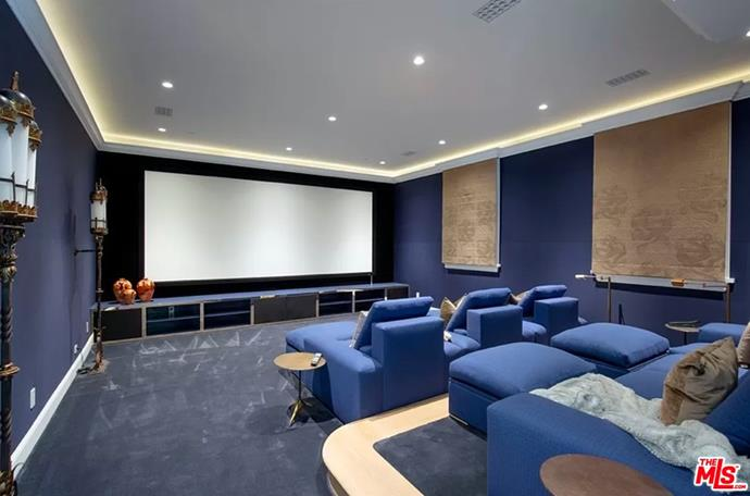 """The at-home theatre room that one can only dream of owning one day. <br><br> *Image by [MLS/Zillow](https://www.zillow.com/homedetails/8-Beverly-Park-Beverly-Hills-CA-90210/20533668_zpid/?