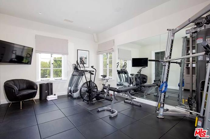 """An indoor gym. <br><br> *Image by [MLS/Zillow](https://www.zillow.com/homedetails/8-Beverly-Park-Beverly-Hills-CA-90210/20533668_zpid/?
