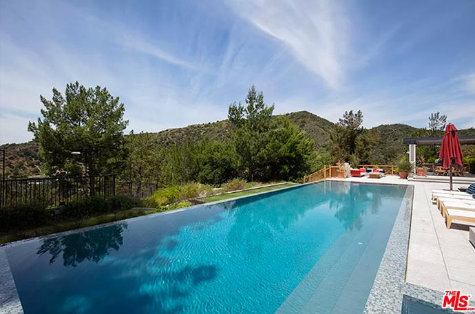 """The infinity pool overlooking hills of Los Angeles. <br><br> *Image by [MLS/Zillow](https://www.zillow.com/homedetails/8-Beverly-Park-Beverly-Hills-CA-90210/20533668_zpid/?