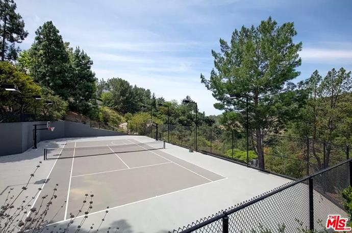 """A personal tennis court and basketball court. <br><br> *Image by [MLS/Zillow](https://www.zillow.com/homedetails/8-Beverly-Park-Beverly-Hills-CA-90210/20533668_zpid/?
