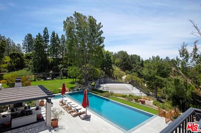 """The entire backyard including courts, pool and garden area. <br><br> *Image by [MLS/Zillow](https://www.zillow.com/homedetails/8-Beverly-Park-Beverly-Hills-CA-90210/20533668_zpid/?