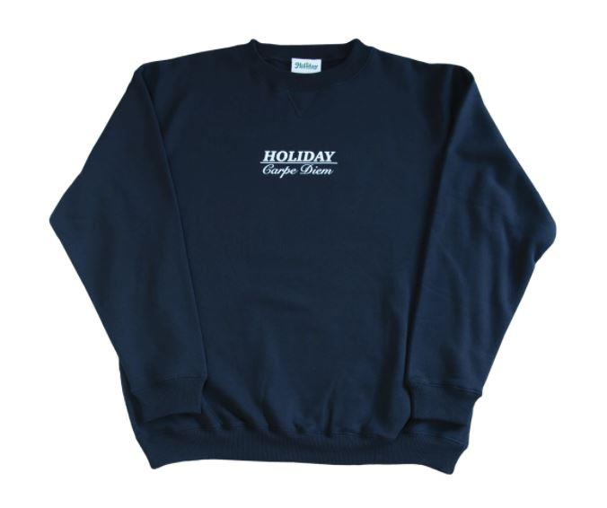 """Carpe Diem Sweater, $120 by [Holiday The Label](https://holidaythelabel.com/collections/outerwear/products/carpe-diem-sweater-navy target=""""_blank"""" rel=""""nofollow"""")."""