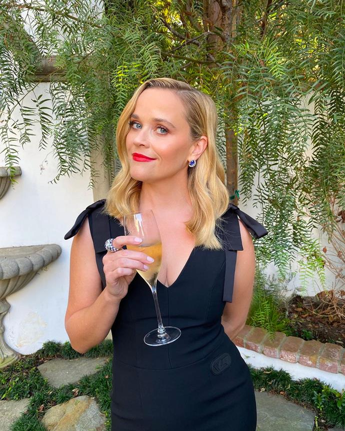 Reese Witherspoon wearing Louis Vuitton from the comfort of her home.
