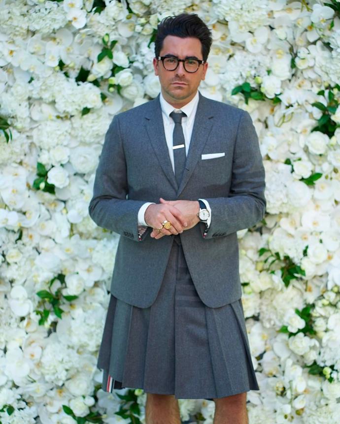 Dan Levy sporting a grey Thom Browne suit.
