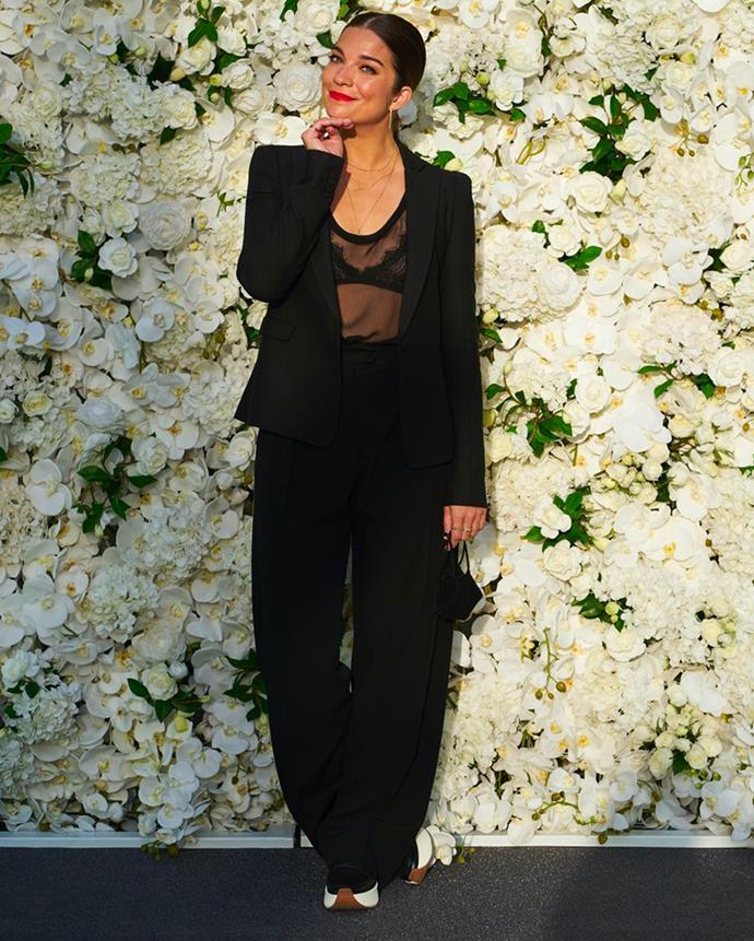 *Schitt's Creek* actress Annie Murphy in an all-black Valentino suit.