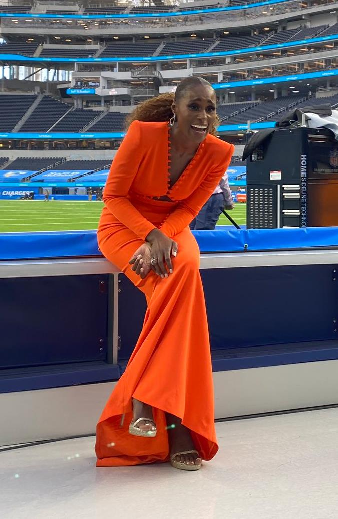 """Issa Rae is a vision in a neon orange Sergio Hudson gown. <br><br> Image credit: [@SoFiStadium](https://twitter.com/SoFiStadium target=""""_blank"""" rel=""""nofollow"""")"""