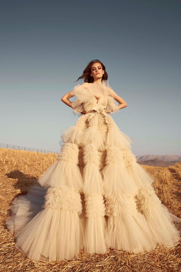 ***Best Bridal Gown: Bridal Fall 2020 / Look 1 from Zuhair Murad***<br><br> Lebanese designer, Zuhair Murad, has outdone himself once again by bringing us the 'Best Bridal Gown' of the year. Although Murad's intentions were to make his Fall 2020 Bridal Collection appropriate for both countryside and black-tie events alike, Look 1 is hard to imagine anywhere other than the most elegant event of the year. This unique masterpiece features dramatic ruffles in organic shades of beige, melding together over-the-top wedding-day glamour with the subtleties of nature's beauty. Full of texture, the layers of this tulle gown create unforgettable ripples which flow down its brilliantly sculpted skirt.