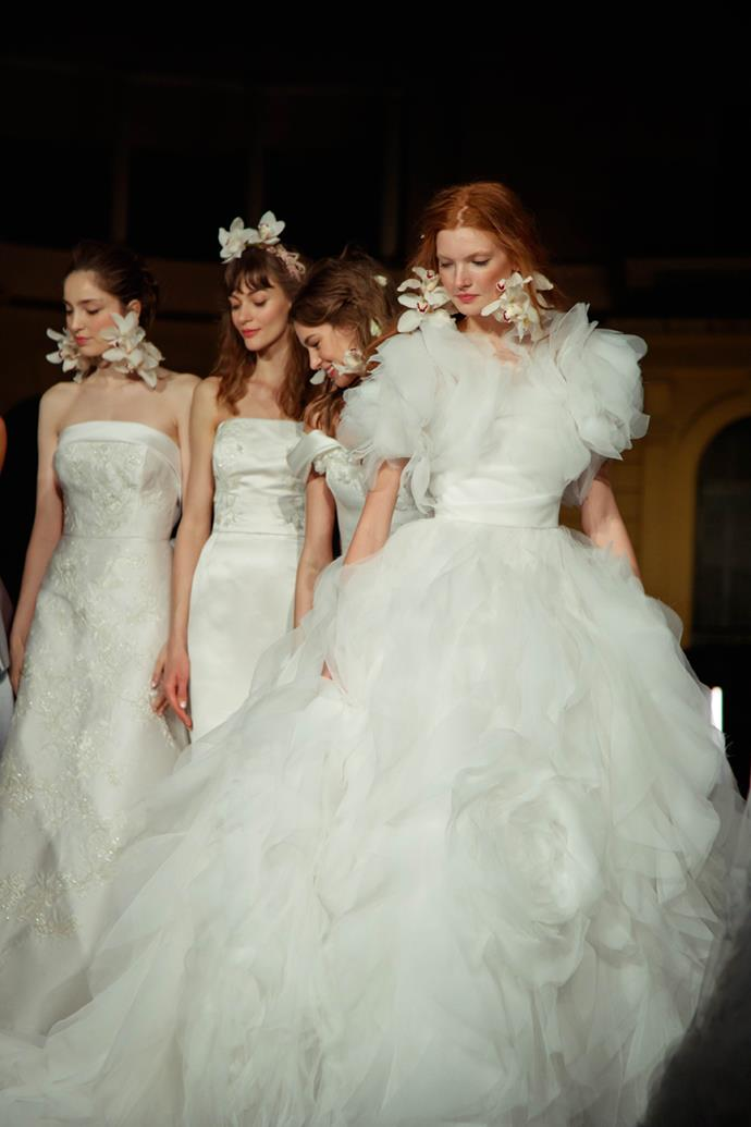 ***Best Bridal Show: Spring 2020 Bridal Show from Marchesa*** <br><br> At this year's Barcelona Bridal Fashion Week, Marchesa's Georgina Chapman and Keren Craig unveiled their Spring 2020 Bridal collection. While guests felt as though they were attending an exclusive intimate wedding ceremony, gowns draped in 3-D petals, crystal embroideries, gigantic bows, and stacked tulle rosettes were just the beginning of what made this show pure magic. Dimmed lights, crystal chandeliers, and wooden furniture transported guests from the runway into a fantastical secret garden wedding ceremony, while the dresses spoke for themselves.