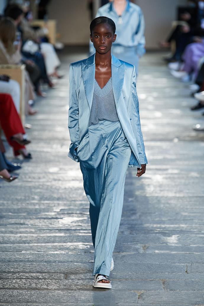 **BOSS** <br><br> As each look sauntered down the runway, all we could focus on was the *wearability* of the pieces. Adapting to the shift towards casualwear, designer Ingo Wilts opted for clean silhouettes in bold colours, and modern tailoring made casual with the perfect amount 'slouch'.