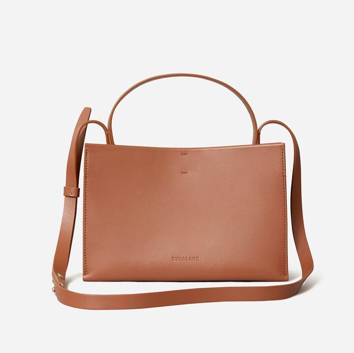"'The Lunchbox Bag', $213 at [Everlane](https://www.everlane.com/products/womens-lunchbox-bag-cognac?locale=AU&utm_medium=cpc&utm_source=pla-google&utm_campaign=9837047751&utm_content=442556530299&utm_term=aud-337553806454:pla-918424280351&adgroup=108291086328&pid=7597-54849&device=c&gclid=CjwKCAjw2dD7BRASEiwAWCtCb80SU21D7TIHsClSF4Ss1UAlv0nmdljTMMT1iSLEdbCd3951E27AqhoC_IYQAvD_BwE|target=""_blank""|rel=""nofollow"")."