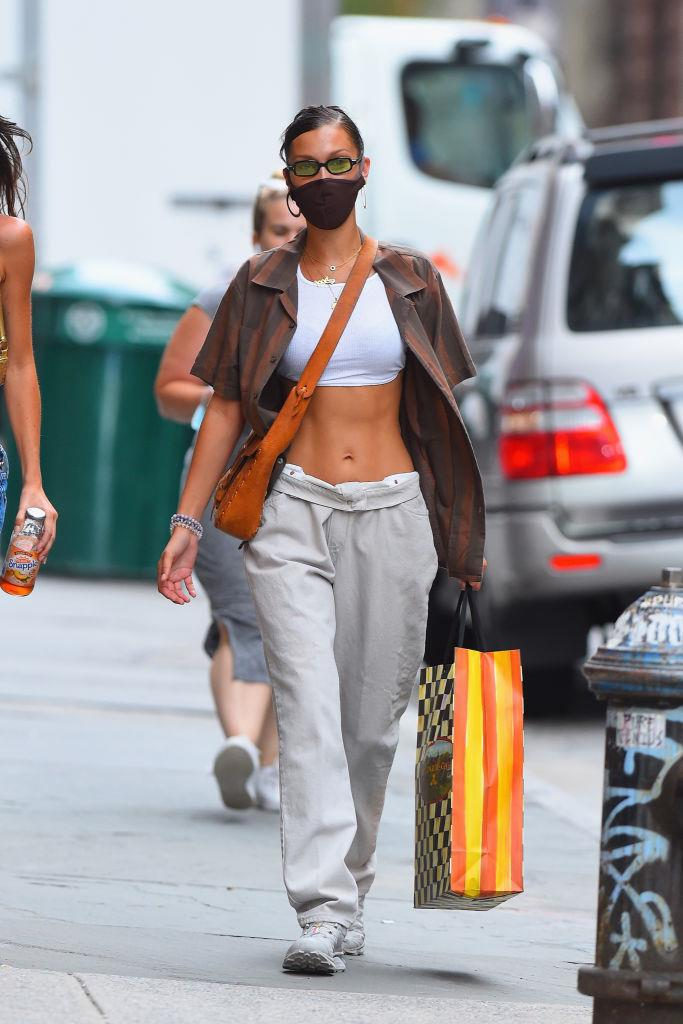 Single-handedly bringing back low-riding pants, we'd also flaunt our abs if they looked like that.