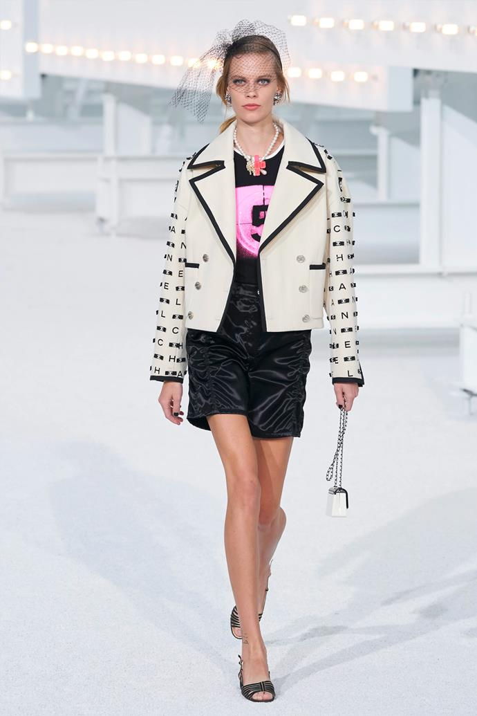 **Chanel**<br><br> Taking place at the Grand Palais, Chanel's latest collection is a tribute to the muses of the fashion house. Very joyful, colourful and vibrant, the collection featured t-shirts printed with the letters of Chanel like neon lights, Old Hollywood–worthy black-and-white gowns, leather shorts and pink Capri pants, and its signature tweed suiting. Need we say more?