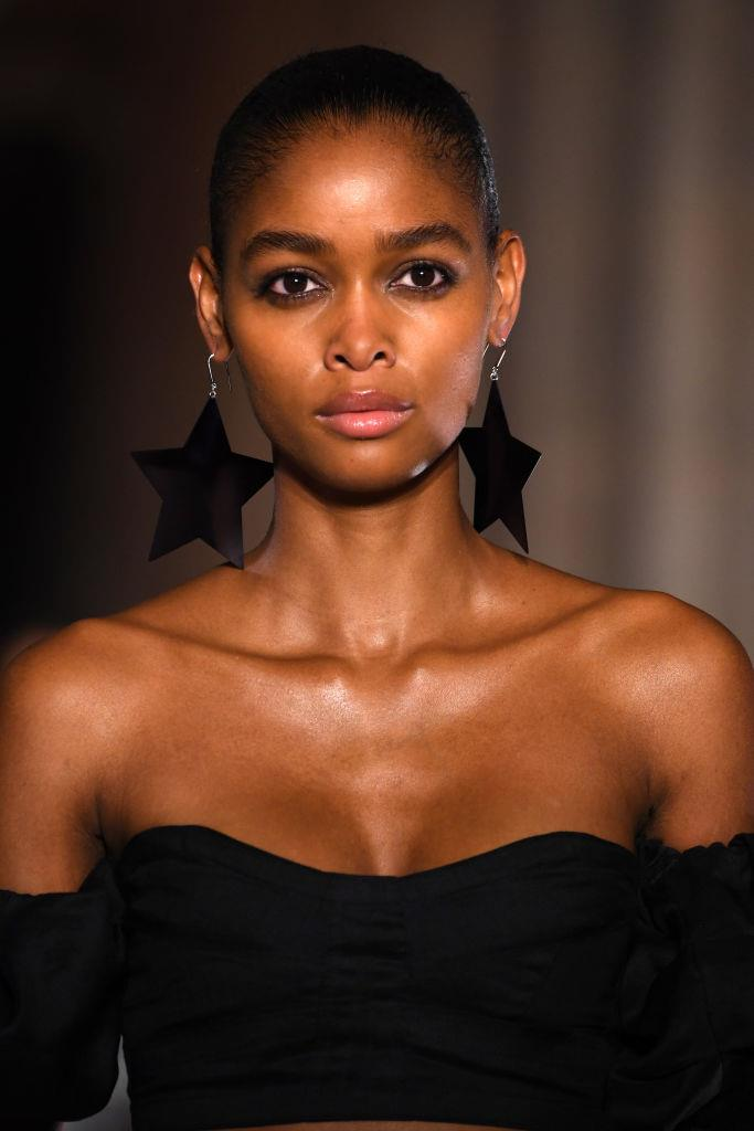 **Isabel Marant** <br><br> Models were all-but bare-faced for Isabel Marant. The exception? A very subdued, slightly grey-ish smokey eye that could just be the new pink shadow.  <br><br>