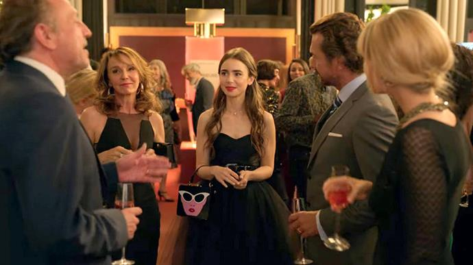 **8. Emily's Black Tutu Dress Moment**<br><br>  Another rare moment where she went understated to blend in (the black tutu dress), but couldn't resist bringing a little bold personality (the Yens 'Face' Acrylic Bag).<br><br>  *Le mood:* The Rosetta Stone might have kicked in (a little).