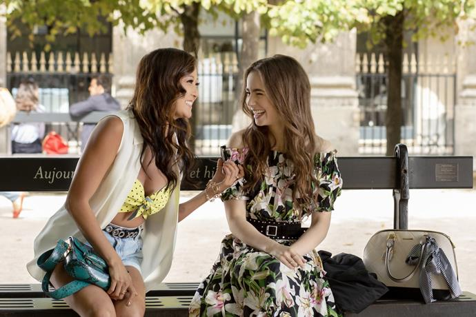 **2. Emily's Floral Dress Moment**<br><br>  Lily Collins wearing a lily print dress? Okay, we know we chastised one of the outfits for being too on-the-nose earlier, but this one is a bit gorgeous, so we're willing to make an exception.<br><br>  *Le mood:* A *flâneur* among the *fleurs*.