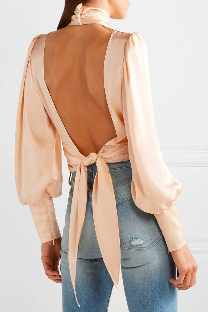 """'Night Out Open-Back Ruched Satin Blouse', $761.14 at [Orseund Iris](https://orseundiris.com/products/night-out-top-champagne?variant=8646240206958