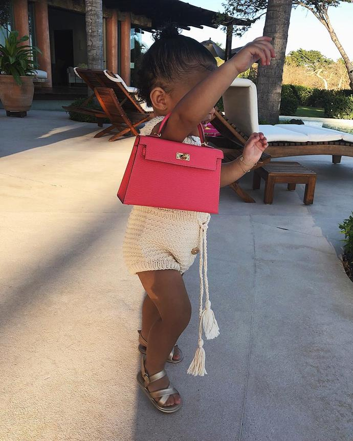 **Stormi Webster** <br><br> And recently she proved she is true to her word, picturing 2-year-old Stormi in just *one* of her designer handbags.