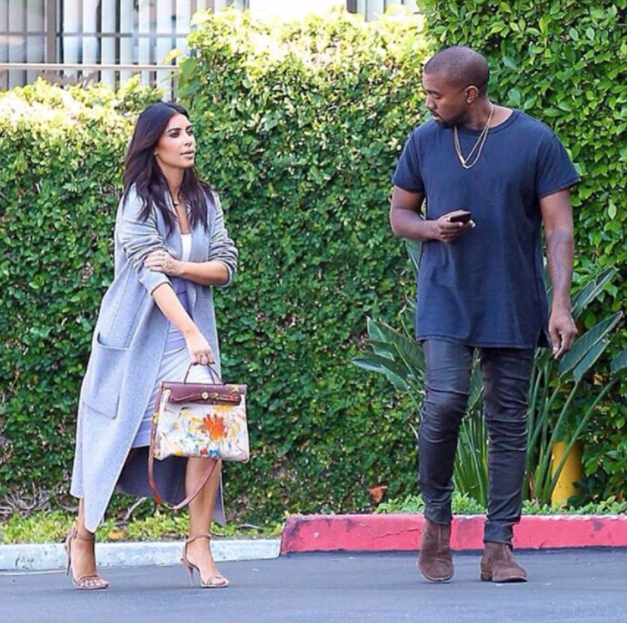 **Kim Kardashian-West** <br><br> Also, who could forget the time West gifted his wife an Hermès Herbag (basically a canvas equivalent of the Birkin) hand-painted by her daughter, North West?