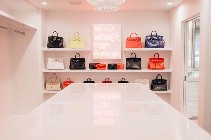 **Kris Jenner** <br><br> Kris Jenner's palatial closet is a feat in itself—but it's her extremely on-brand Birkin section, featuring a neon sign that reads simply 'NEED MONEY FOR BIRKIN', that definitely takes the cake.