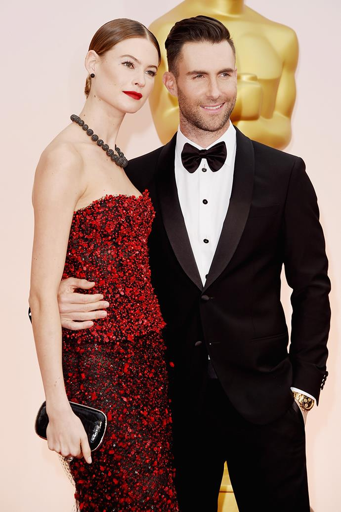 """**Adam Levine and Behati Prinsloo**  <br><br> The Victoria Secret Angel first met the Maroon 5 singer when the band were looking to cast for an upcoming music video. Prinsloo turned down the job, but the pair continued to stay in touch, with Levine eventually asking her out for dinner. In 2019, the model confessed that they had split for two months but soon """"realised that it was the worst decision,"""" resulting in their reunion and subsequent engagement in July 2013. <br><br> According to [*People*](https://people.com/celebrity/adam-levine-married-maroon-5-rocker-weds-behati-prinsloo-in-mexico/