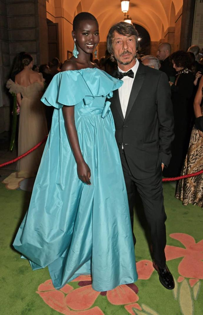 """**Pierpaolo Piccioli and Adut Akech** <br><br> Piccioli's work as creative director of Valentino is highly acclaimed by fashion critics, and supermodel-in-the-making Adut Akech could be considered his main muse. Akech is a former refugee who escaped war-torn South Sudan during her childhood, and eventually settled in Australia before becoming a model. <br><br> In a 2019 interview with *[Business of Fashion](https://sg.style.yahoo.com/adut-akech-pierpaolo-piccioli-makes-feel-accepted-010000157.html target=""""_blank"""" rel=""""nofollow"""")*, Akech said that her work with Valentino makes her feel """"at home"""", adding: """"I can come [to the atelier] for a fitting and I could be having the worst day, but I just leave everything behind that door. Pierpaolo puts me in clothes where I can really be myself. I love that.""""<br><br> Since 2018, Akech has opened and closed various Valentino shows, and has worn Piccioli's designs to the Met Gala (twice). She also appeared alongside Anwar Hadid in Valentino's 'Roma' fragrance campaign in 2019."""