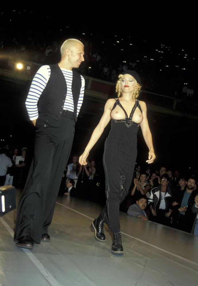 **Jean Paul Gaultier's charity benefit in 1993**<br><br>  For a charity benefit in 1993, singer Madonna shocked the world by parading the runway in an exposing overall dress. Many now consider the look to be a legendary fashion moment.