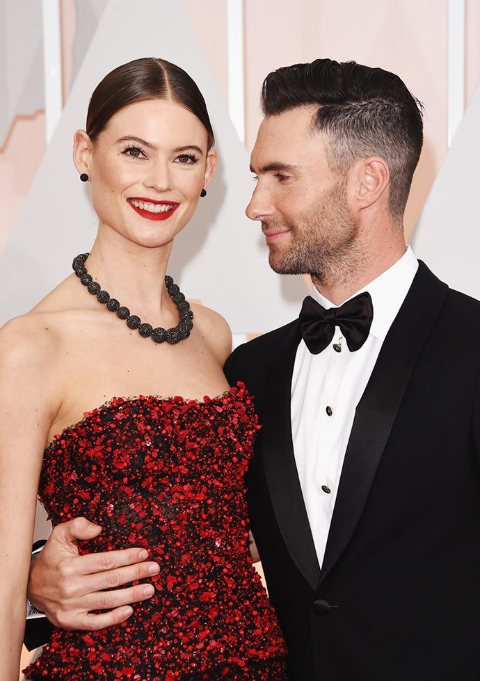 "**Behati Prinsloo and Adam Levine** <br><br> ""When we met, finally, face-to-face, he was shooting the boxing music video, 'One More Night.' So he had gloves on,"" Prinsloo said of their first meeting. ""And I walked through the door, I was like, 'What am I doing here? What is happening?' And he had his gloves and he came down and he was like, 'This is awkward. Hi.' But he was very sweet."""
