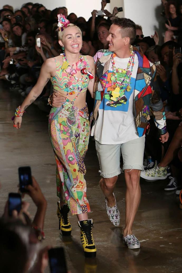 "**Miley Cyrus for Jeremy Scott spring/summer 2015 at New York Fashion Week**<br><br>  Miley Cyrus took to the runway in 2014 to show off her [jewellery collaboration](https://www.elle.com/fashion/news/a15461/miley-cyrus-jeremy-scott-interview/|target=""_blank""