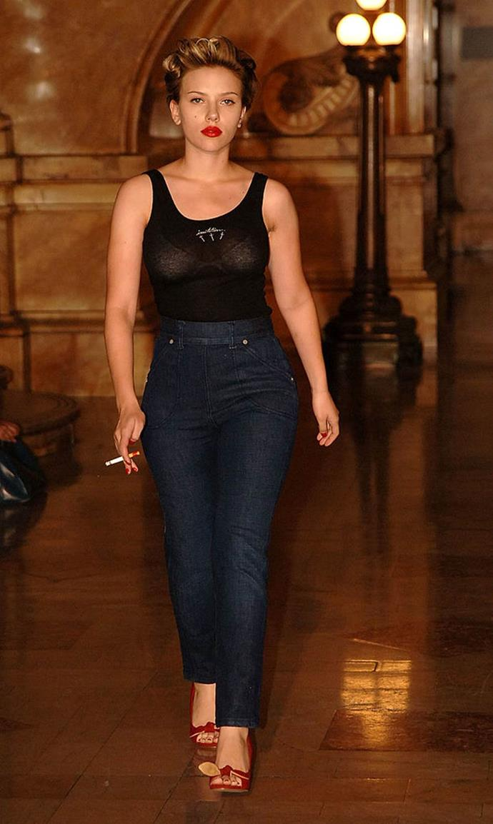 **Scarlet Johansson for Imitation Of Christ spring/summer 2006 at Olympus Fashion Week in New York City**<br><br>  Hollywood heavyweight Scarlett Johansson made her runway debut for Imitation Of Christ in 2005, channelling a Marilyn Monroe-esque character in a sheer black tank top and retro-style high-waisted jeans.