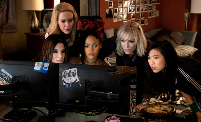 ***Ocean's 8* (2018)** <br><br> The all-female sequel to the *Oceans* trilogy, sees Debbie Ocean (Sandra Bullock) put together a motley crew of women, all with their own special set of skills, to steal a priceless piece of jewellery (and then some).  <br><br> Not only are the cast a tour de force, but getting to swoon over luxurious fashion and jewels is a highly-rated bonus.